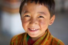 Lächelnder Junge in Bhutan