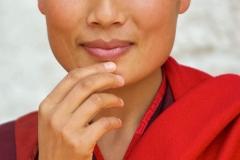 Hände einer Nonne in Punakha, Bhutan